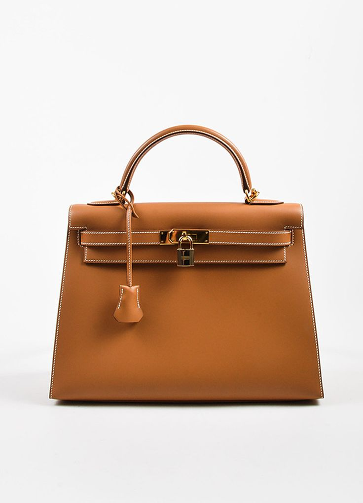 "Elegant Hermes Kelly bag that is an iconic wardrobe treasure. This stunning accessory in the ""32 cm"" size features the smooth and supple ""Chamonix"" leather (the matte version of box calf) in the ""Natu"