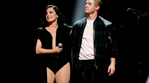 Demi Lovato and Nick Jonas perform onstage during the kickoff of their Future Now tour on June 29 in Atlanta.