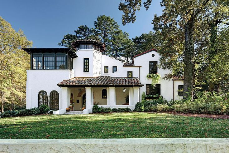 At a historic Birmingham estate built in 1927, the clay-tiled porch roof is a nod to traditional Spanish design.