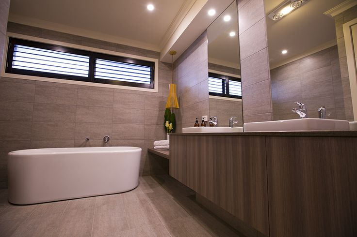 We just love this stunning bathtub, which gives this spacious bathroom a luxury hotel feel. #worldconcepthomes #bathroom