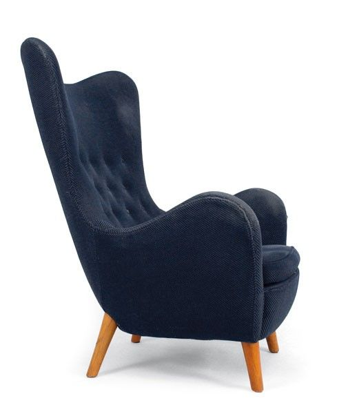 Runar Engblom. Lounge chair, designed in 1952 for 'Hotel Vaakuna' Helsinki. H. 106 x 82 x 88.5 cm. Made by Boman Oy, Helsinki. Oak, blue fabric upholstery.