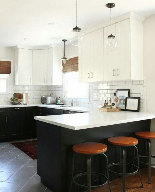 White uppers, black lowers, subway tile, white countertops, wood and metal barstools, bamboo blinds