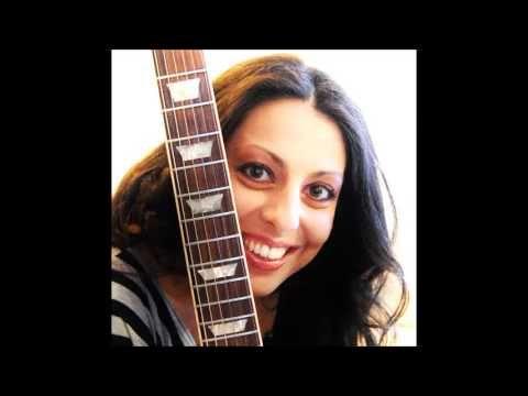 """""""Chitarrista, compositrice e autrice, artista emergente che ha fatto della musica indipendente la sua bandiera. Nata a Livorno nel '78, dopo aver studiato per un breve periodo pianoforte e flauto traverso, Manuela nel '95 inizia a studiare chitarra e nel '98 ha le prime esperienze con l'hard rock/heavy metal, generi che daranno un'impronta importante al suo modo di suonare anche se in seguito sperimenterà altri stili...."""""""