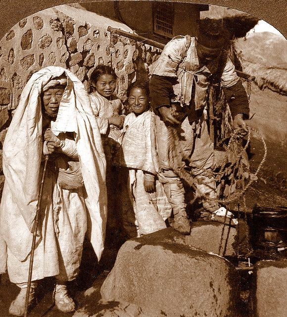 OLD KOREA - LAND OF THE MORNING CALM -- Happy boys with grandmother and the water boy, SEOUL   unknown photographer ca 1899-190?