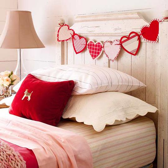 Heartfelt Garland  To make a garland of hearts, cut an even number of heart shapes from fabric scraps. Layer the hearts in pairs and attach pairs of hearts together with fusible web. Punch small holes in the sides of the hearts and tie them together with ribbon.