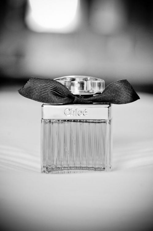 Perfume bottles are a unique and modern way to display guest names on tables at a wedding. #table #decor #glass #modern #wedding #silver