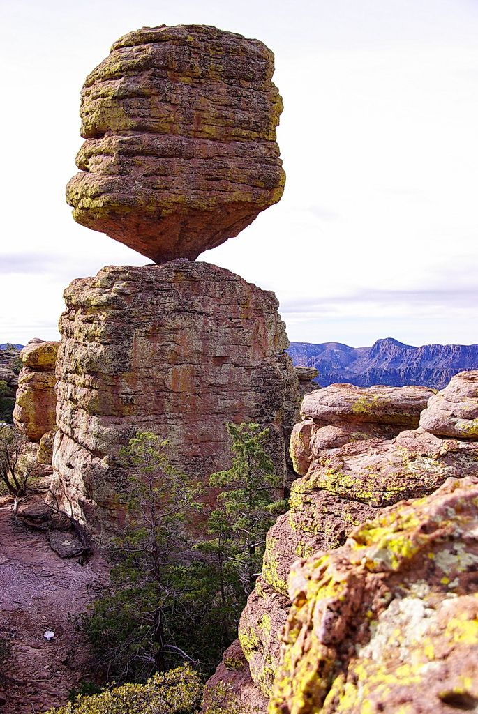 "https://flic.kr/p/bjzV2a | Big Balanced Rock - Chiricahua National Monument | I went to Chiricahua National Monument for a weekend of hiking, camping and adventure. I had never been here even though I had heard a lot about it.   This is the Big Balanced Rock on the Balanced Rock Trail.  It is 25 feet tall, 22 feet in diameter and weighs 1,000 tons   ""The rock pinnacles, or hoodoos, which the monument was primarily created to protect, are erosional features composed of welded rhyolite tu..."