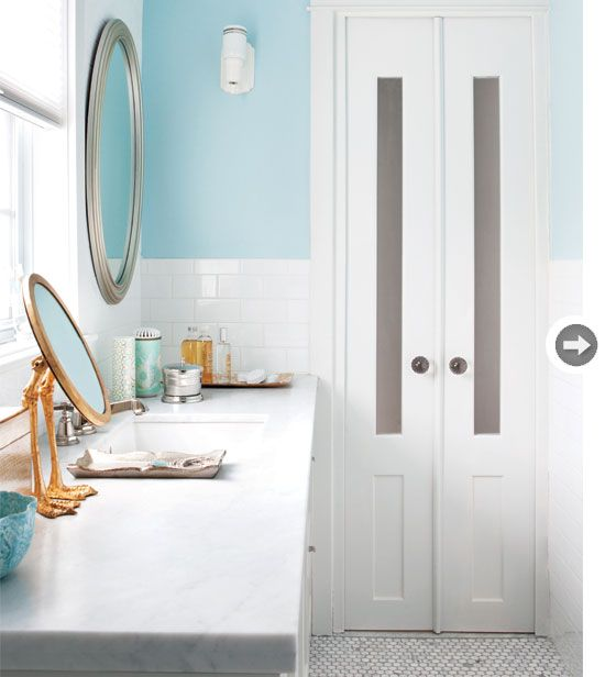 Two panels from a closet door are made into a mini double door in this bathroom. {PHOTO: Virginia Macdonald}