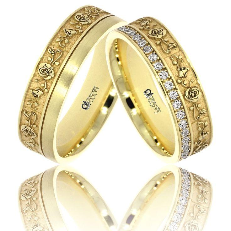 Verighete ATCOM Lux ROSA aur galben    Aceste doua inele de casatorie se disting printr-un design deosebit, creat prin gravura exterioara a unui model fermecator cu trandafiri, executat cu cea mai noua tehnologie laser din lume si corectat cu multa migala si rabdare de maistrul nostru gravor.  Modelul poate fi realizat si din aur roz sau alb.