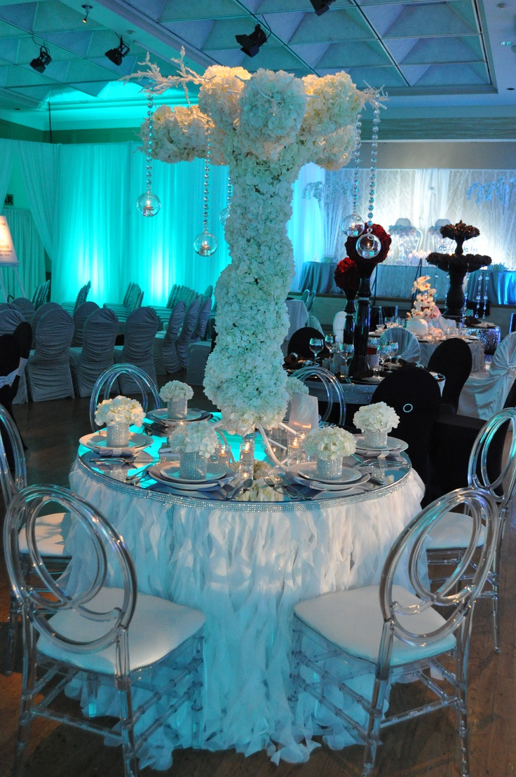 White flowers and blue lighting help create
