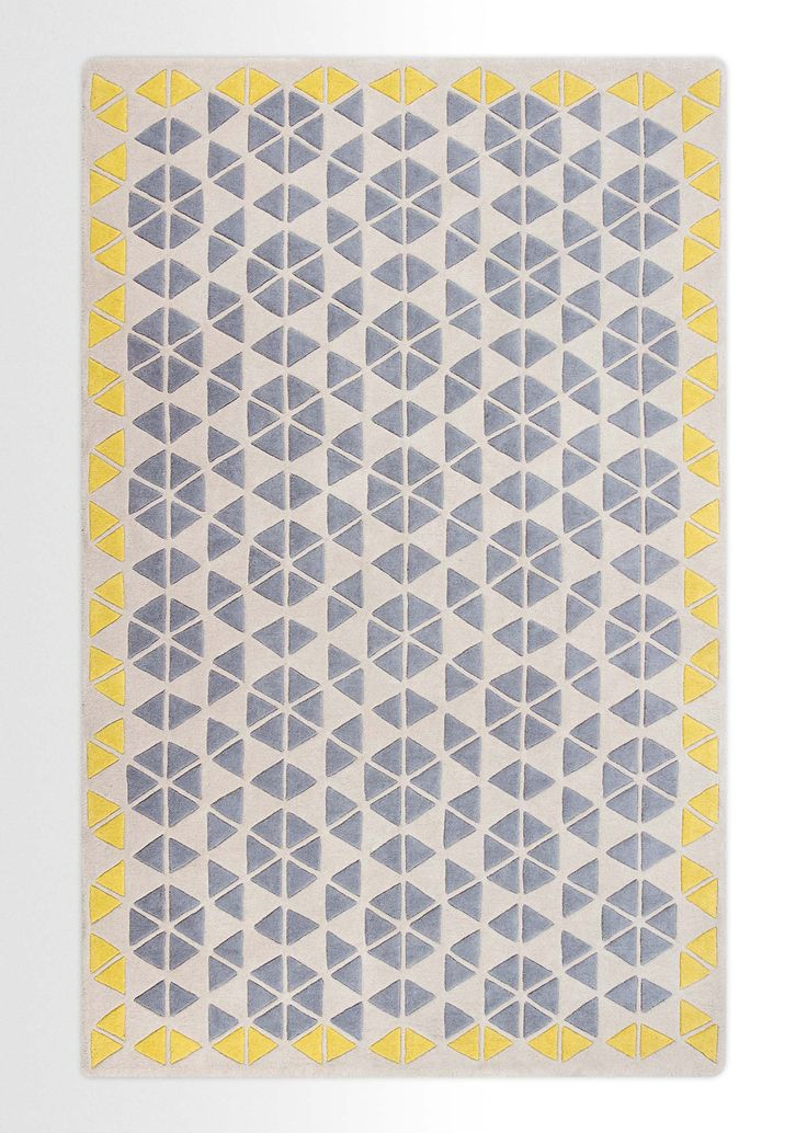 Super-soft and springy underfoot, this rug is made for sinking your toes into. Designed by Genevieve Bennett, this contemporary rug plays with geometric patterns and is 100% wool.