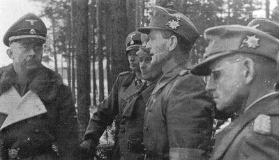 "Foto ini diambil pada tanggal 12 Januari 1944 pada saat kunjungan Himmler dan Model ke tempat latihan Waffen-Gebirgsjäger Regiment der SS 28/13. Waffen-Gebirgs-Division der SS ""Handschar"" di Truppenübungsplatz Neuhammer (Jerman). Dari kiri ke kanan: Reichsführer-SS Heinrich Himmler (Chef der SS und Deutschen Polizei); SS-Brigadeführer und Generalmajor der Waffen-SS Hermann Fegelein (Chef des Amtes VI - Reit und Fahrwesen - im SS-Führungshauptamt); Generaloberst Walter Model (Oberbefehlshaber…"
