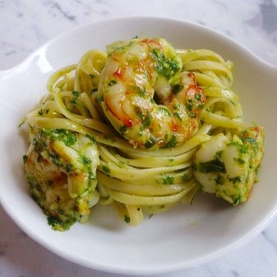 Fresh herbs, a sprinkle of Parmesan and a little lemon citrus complement sweet, freshly sauteed garlic shrimp.