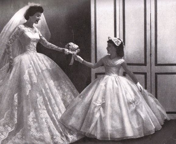 An ad from 1958. The 1950's was one of the prettiest era's in bridal fashion, just my opinion, of course.