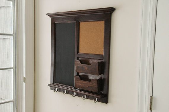 This is a custom wall mail organizer with a walnut stain and lacquer finish. It features a large magnetic chalkboard, corkboard, and two mail boxes.