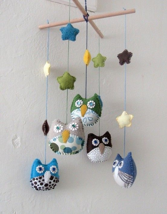 Mobile. http://www.etsy.com/listing/70416592/personalized-children-owl-mobile-made-to