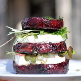 Stacked goat cheese beat salad - great for individual portion servings at a party with a decorative pick holding the layers together.