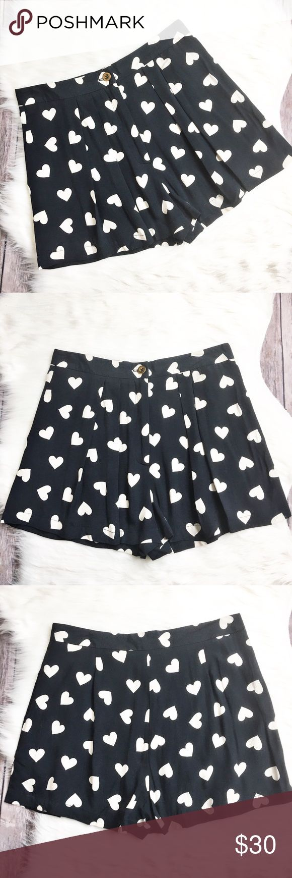 Topshop 💜 Shorts Adorable shorts made by Topshop.  Navy blue in color with cream colored hearts. Features a pleated front with pockets. Material is made of 100% viscose. Measurements laid flat: waist 14 inches, hip 19 inches, and inseam 2 inches. Shorts are in very good condition. Topshop Shorts