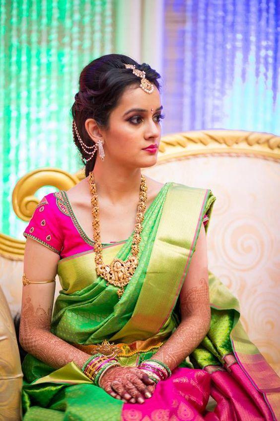 South Indian bride. Gold Indian bridal jewelry.Temple jewelry. Jhumkis. Pink and green silk kanchipuram sari.Braid with fresh flowers. Tamil bride. Telugu bride. Kannada bride. Hindu bride. Malayalee bride.Kerala bride.South Indian wedding.:
