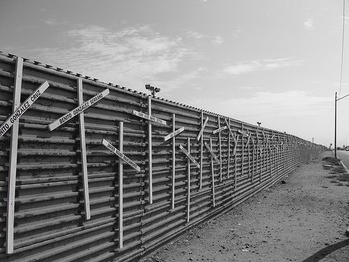 """Near the San Ysidro border crossing, between San Diego and Tijuana, a long wall of crosses acts as a memorial to those who lost their lives trying to cross from Mexico into the United States. Some crosses bear names, others simply say the Spanish word for """"unidentified."""""""
