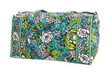 The Large Duffel (in Island Blooms) holds its share and doubles as an over-sized pillow in a packed car
