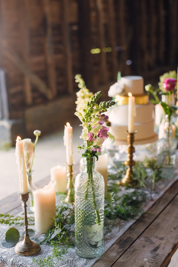 Cake Table Flowers Bottles Feathers Candles Table Decor Boho Blossom Summer Wedding Ideas http://www.catlaneweddings.com/