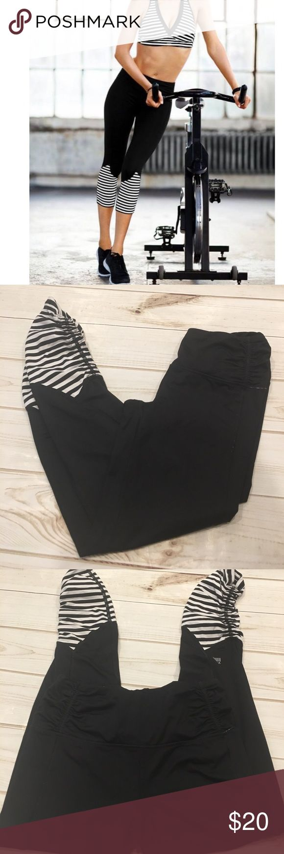 """🆕 Victoria's Secret VSX Sport Leggings Victoria's Secret Sport black showtime tight workout leggings. High rise, ruching on the back, and draw string at the ankle where you can cinch to shorten the length. Black and white stripes on the ankle/calf. Very good used condition. Inseam is 26.5"""" Victoria's Secret Pants Leggings"""
