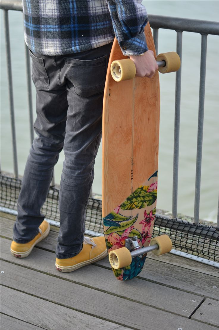 Handmade recycled timber longboard. Made from reclaimed Hemlock and glassed with eco friendly epoxy resin with a fabric inlay. Complete with Paris trucks and Cadillac wheels.