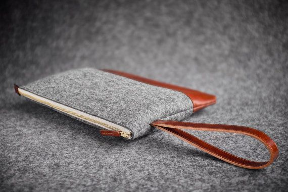 Accessories Pouch / Handmade sturdy padded bag made of a quality grey wool felt and vegetable tanned cow leather. _ _ _ _ _ _ _ _ _ _ _ _ _ _ _ _ _ _ _ _ _ _ _ _ _ _ _ _ _ _ _ _ _ _ _ _ _ _ _ _ _ _ _ _ MAKERS NOTES  Hand crafted zipper pouch. Outer dimensions 19 cm x 26 cm.  Sturdy design - bottom is leather only, top is 2 mm wool felt.  Leather loop handle on side of the pouch.  Leather in semigloss chocolate brown tan. Dense short stitches in grey and brown color. Elegant, simple and d...