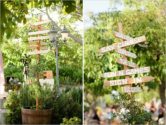 wedding sign in old wheel barrel- cute idea for a stand, or in a wheelbarrow with drinks :)