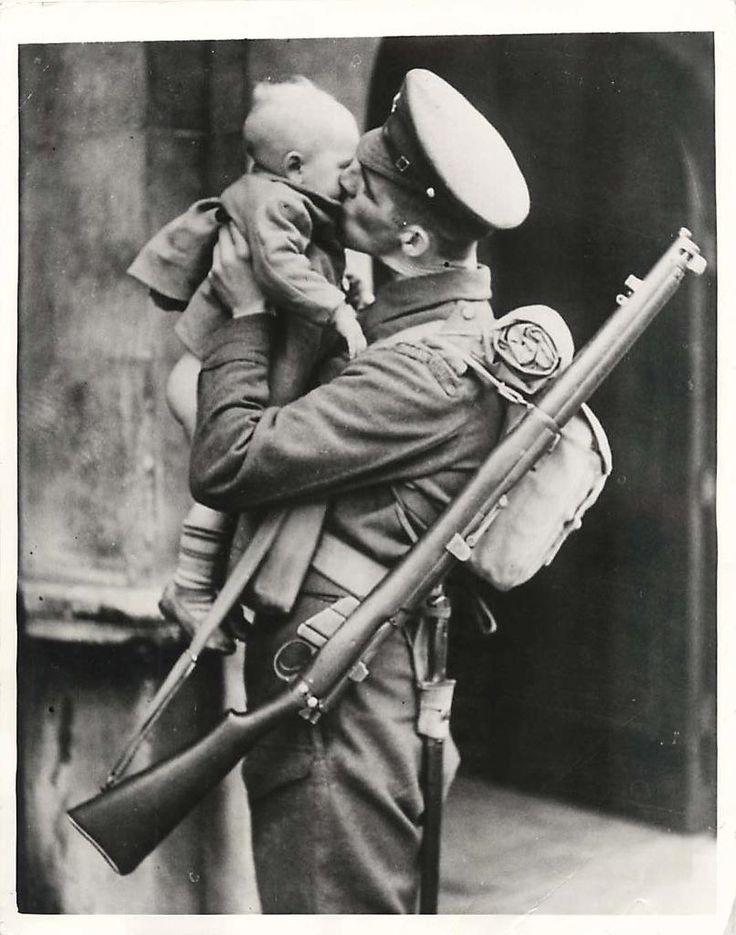 1941- Guardsman returning to duty after being home on leave kisses his little son, who in the excitement of the moments seems to have lost his pants.