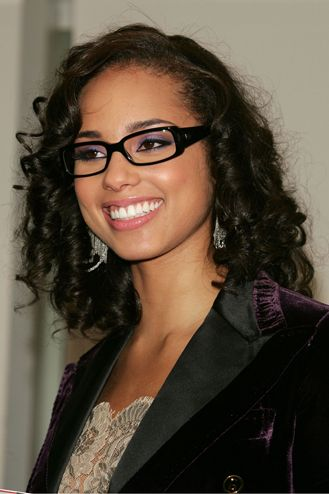 Attractive woman wearing #bifocal #glasses with extremely long curly black hair street style.