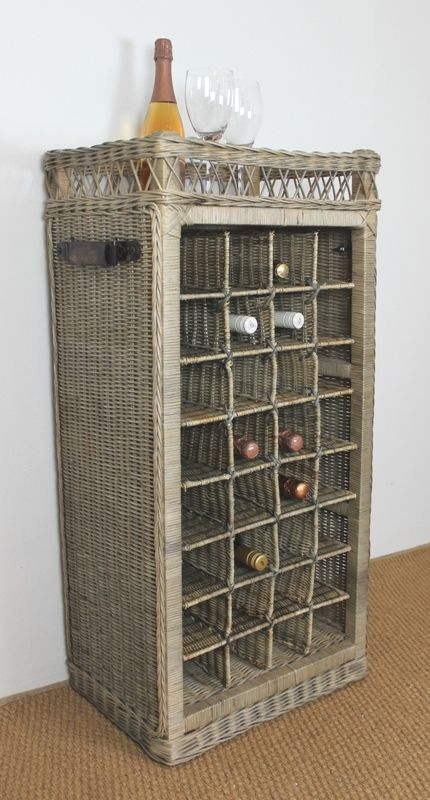 This lovely rattan Wine storage basket has space for 32 of your finest bottles and has top shelf space. With vintage leather handles it has a Greywash finish #rattan #french #frenchinspired
