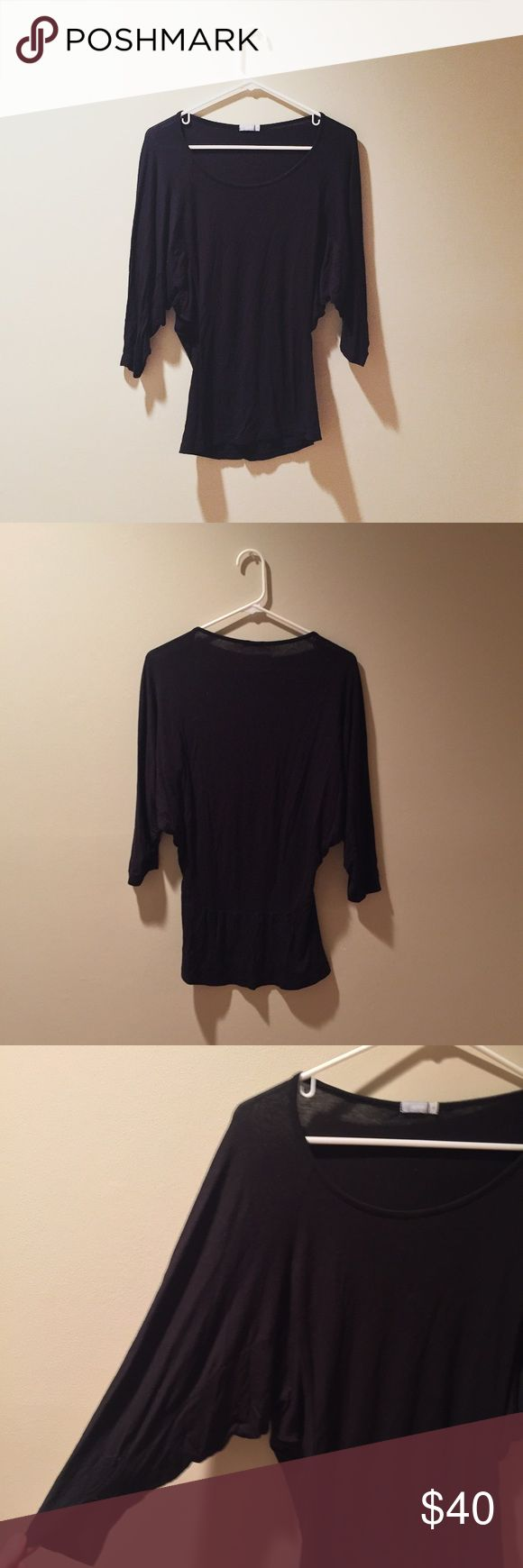 black batwing top brand:  urban (not urban outfitters! bought overseas). tight fitted black batwing top with scoop neck. very versatile! size medium but can fit a size small. in excellent condition!   🍃 10% off bundles! 🍃 always open to offers! 🍃 feel free to leave any questions or comments! Urban Outfitters Tops Tees - Long Sleeve
