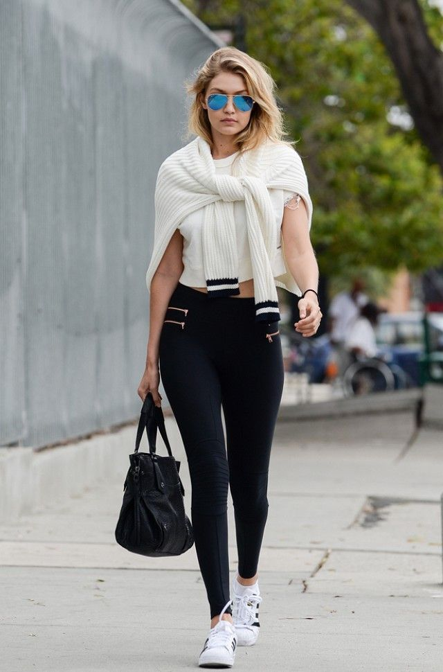 Style muse Gigi Hadid rocking our fierce Zipper Moto Leggings. #athleisure  www.inflowstyle.com