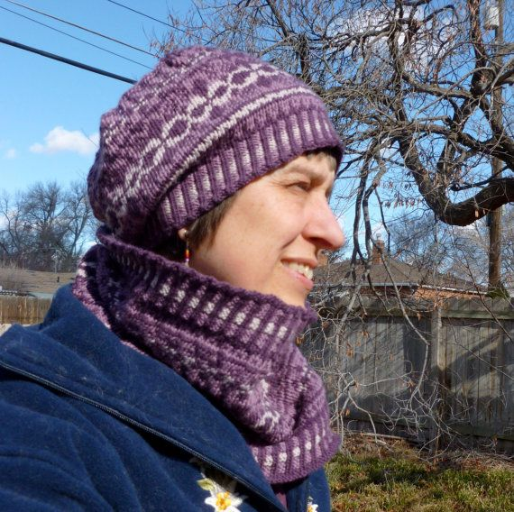 Knitting Pattern Hat and Cowl Set PDF--Winter Arabesque Hat and Cowl stranded knitting pattern set  Keep the winter chill away with Winter Arabesque Hat and Cowl set. Winter Arabesque Hat has a slightly slouchy look. Bands of motifs in three colors complement the corrugated ribbing. The pattern comes with charts for the 4 hat sizes and instruction and a chart for the cowl. Click through to purchase. #WinterArabesque, #KunstwerkDesign