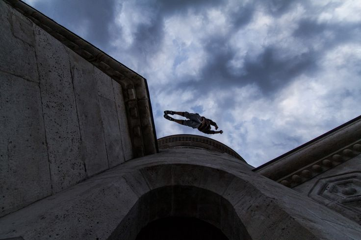 Parkour practitioner jumping across the Fisherman's Bastion in Budapest