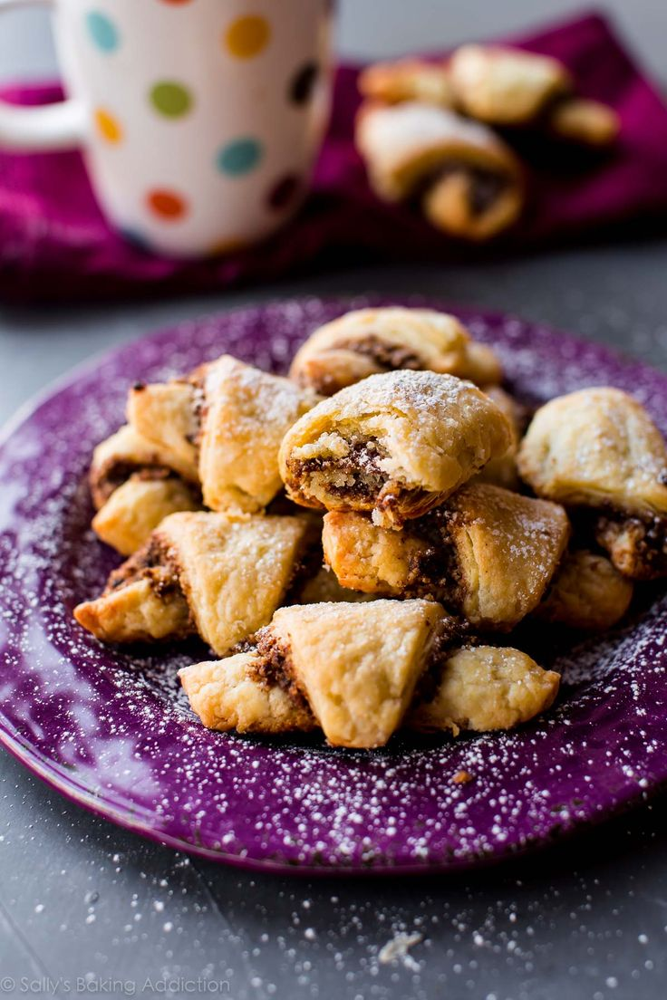 Ever wonder how to make rugelach cookies? These filled cookies have a buttery, flaky crust and are filled with sweet cinnamon walnut filling! Recipe on sallysbakingaddiction.com