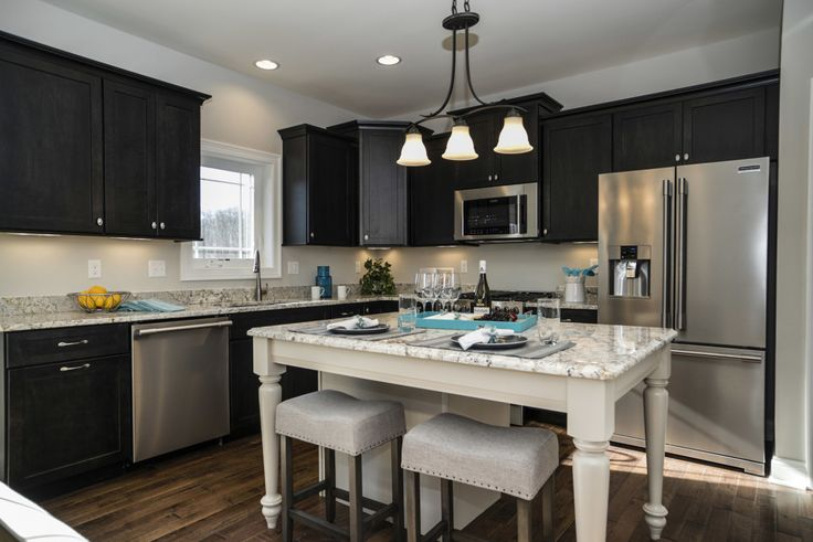 Furniture style island with granite countertop is the focal point of the Dayton model's ktichen.