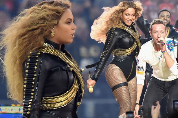 Beyoncé  and Chris Martin perform on stage during Super Bowl 50 Halftime Show