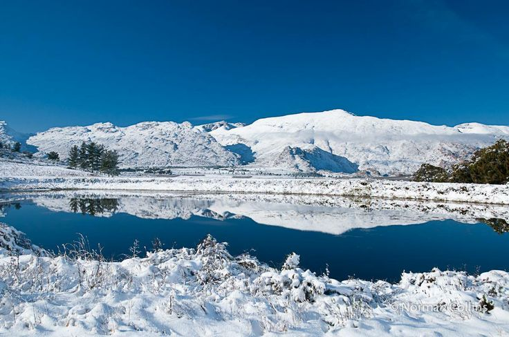 """Photo submitted by Coral Browne Grobler taken by Norman Collins """"Mountains and dam at Klondyke Farm"""
