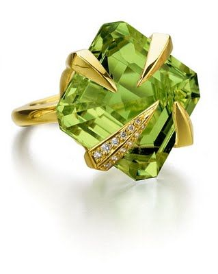 Tito Pedrini ring. The design kinda looks like the claws of a golden dragon are clutching onto a gemstone.