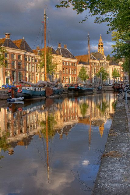 Canalhouses of Groningen reflecting in the canal, The Netherlands