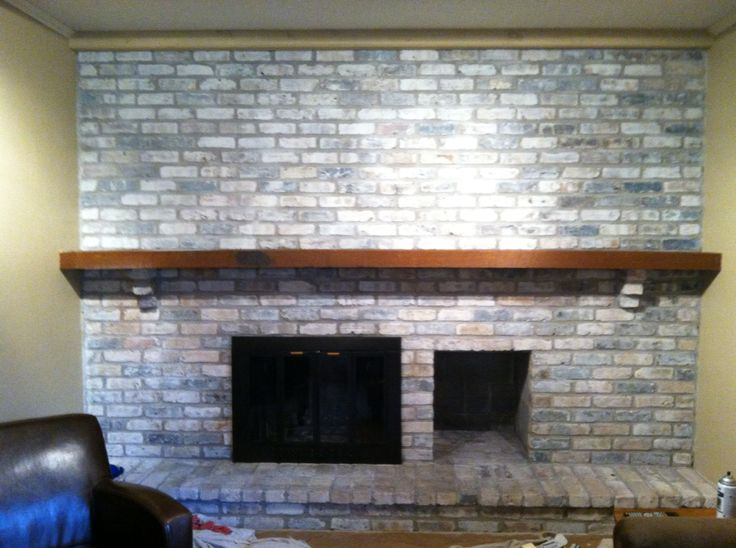 Whitewashed fireplace. Nice way to lighten a dark room.