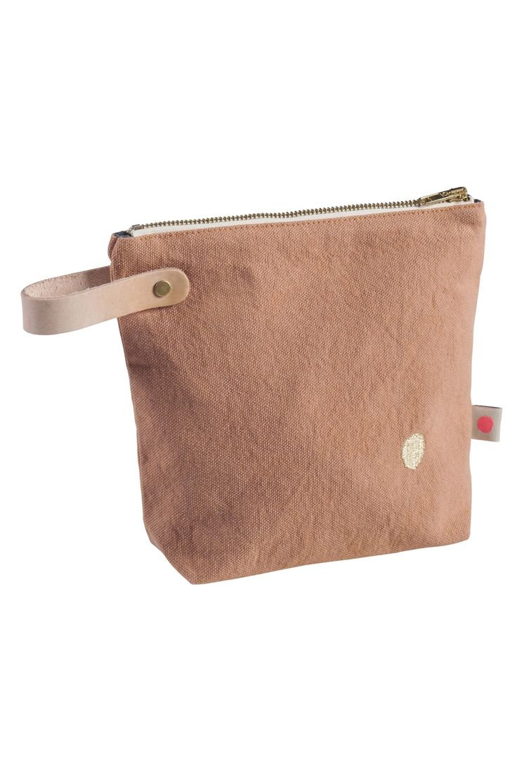 22 X 18 Litchi Iona Toiletry Bag : A small toiletry bag in a Litchi colour with waterproof lining from La Cerise Sur Le Gateau. Ideal for travelling and as a make-up bag. Its leather handle and its golden embroidered dot give it a look that's Oh So Chic!