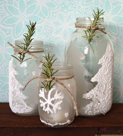 Frosted and flocked pine trees make these easy winter themed luminaries have a beautiful glow.