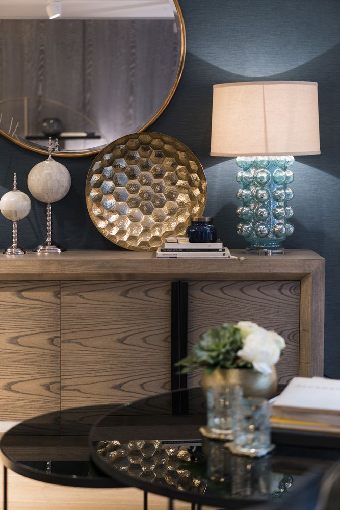 This bold sideboard in smoked ash is invigorated by the unique, 1960s-inspired Julian Chichester glass table lamp with an aged silver patina - handblown by gifted artisans. #interiordesign #luxurylife #luxury #london #luxuryproperty #luxuryhomes