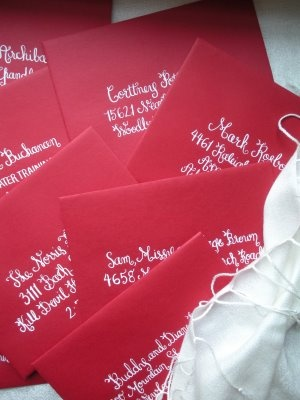#red envelopes with white calligraphy - so pretty!...our color would be orange