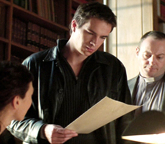 James reading the script behind the set of Revelation