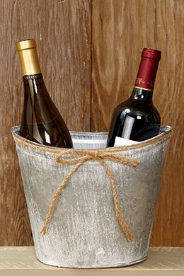 Metal Bucket Oval 7.5in $5 or 10/$40 These would be great on the tables to put bottles of wine in....if you are serving alcohol...